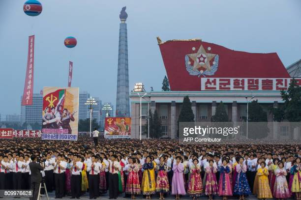 In a photo taken on July 6 2017 participants stand in formation during celebrations marking the July 4 launch of the Hwasong14 intercontinental...