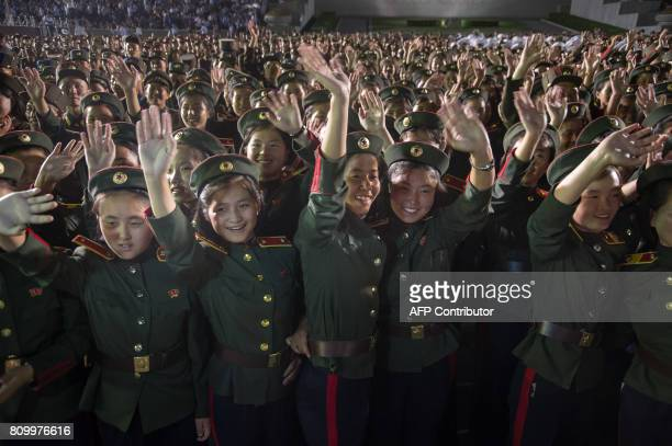 In a photo taken on July 6 2017 soldiers of the Korean People's Army watch a fireworks display as part of celebrations marking the July 4 launch of...