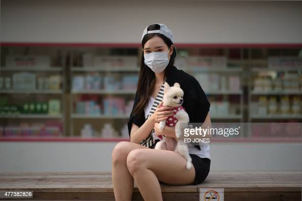In a photo taken on June 16 2015 mask wearer Marina Ahn poses for a photo on a street in the Sinchon area of Seoul As the death toll from MERS mounts...