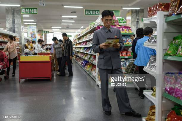 In a photo taken on June 4 2017 customers shop for North Koreanproduced food at the Kwangbok department store supermarket in Pyongyang The North...