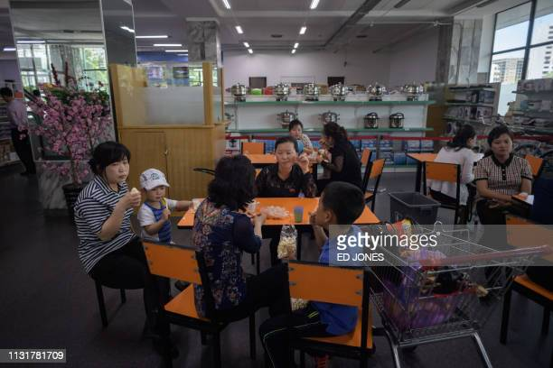 In a photo taken on June 4 2017 customers sit in the Kwangbok department store supermarket in Pyongyang