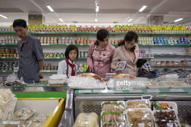 In a photo taken on June 4 2017 shoppers browse products on display at the Kwangbok or 'liberation' department store in Pyongyang / AFP PHOTO / Ed...