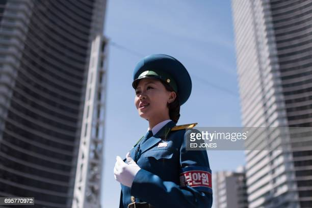 TOPSHOT In a photo taken on June 5 2017 a traffic security officer stands on duty at an intersection in Pyongyang Officially known as traffic...