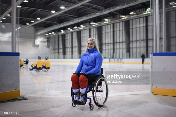 In a photo taken on March 11 Paralympic ice hockey player Lena Schroeder of Norway poses for a portrait following a training session at the Gangneung...