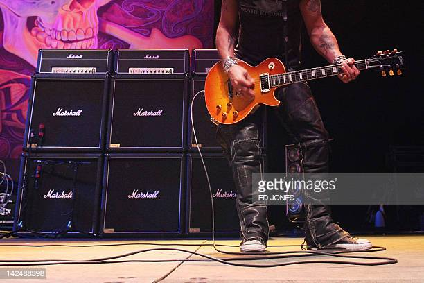 In a photo taken on March 22 Marshall guitar amplifiers are used by guitarist Slash during a concert in Hong Kong Jim Marshall the guitaramp pioneer...