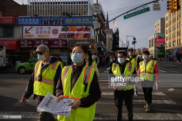 In a photo taken on March 23, 2021 members of the Public Safety Patrol, a volunteer anti-hate crime group, patrol in the Flushing neighborhood of...