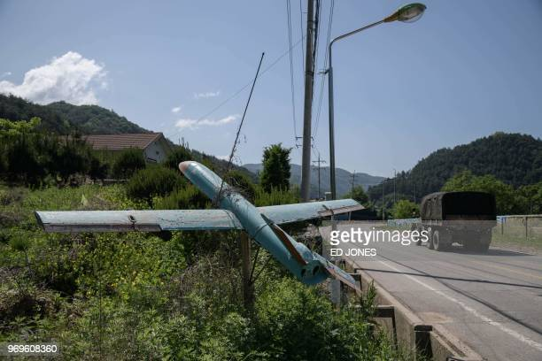 In a photo taken on May 31 2018 South Korean soldiers walk across a bridge near Haeanmyeon near the Demilitarized Zone separating North and South...