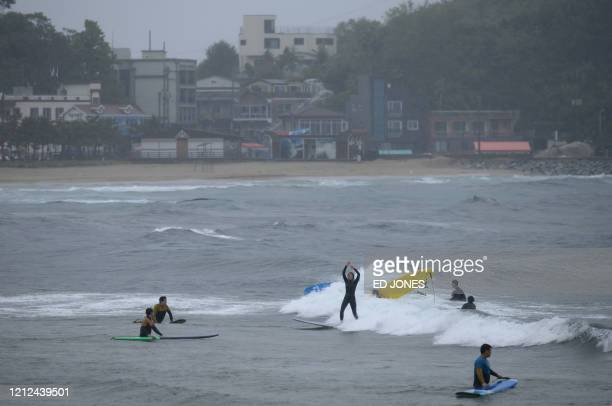 In a photo taken on May 9 2020 a surfer rides a wave at Jukdo beach near Sokcho