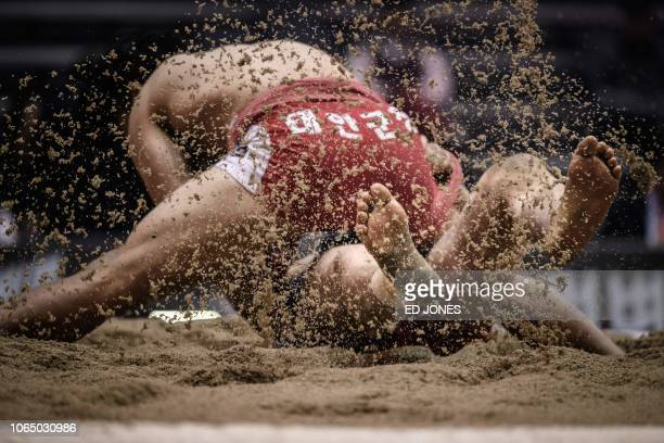 TOPSHOT In a photo taken on November 19 2018 ssireum wrestlers compete during the 80kg qualifying round of the Korea Open Ssireum Festival in Andong...