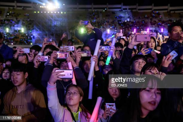 In a photo taken on October 11 audience members watch Kpop bands performing at the 'Kpop World Festival' in Changwon At the grandly titled and...