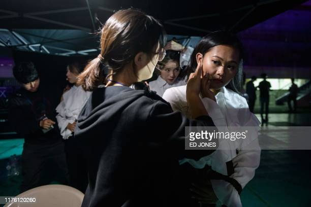 In a photo taken on October 11 competitors from Canada prepare backstage prior to their performance at the 'Kpop World Festival' in Changwon At the...