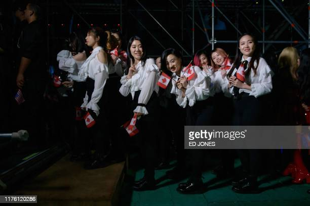 In a photo taken on October 11 competitors from Canada queue to enter the stage prior to their performance at the 'Kpop World Festival' in Changwon...