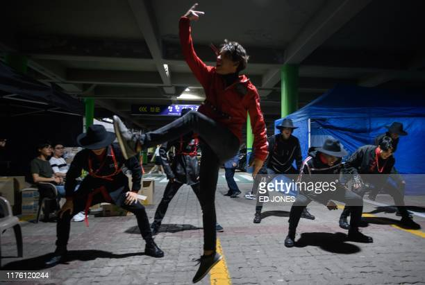 In a photo taken on October 11 competitors from Cuba practice backstage at the 'Kpop World Festival' in Changwon At the grandly titled and...