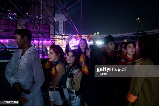 In a photo taken on October 11 competitors from Spain queue to enter the stage prior to their performance at the 'Kpop World Festival' in Changwon At...