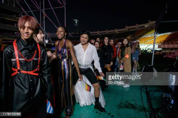 In a photo taken on October 11 competitors queue to enter the stage prior to their performance at the 'Kpop World Festival' in Changwon At the...
