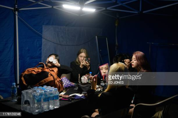 In a photo taken on October 11 performers from Cambodia prepare backstage at the 'Kpop World Festival' in Changwon At the grandly titled and...