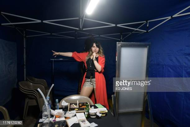 In a photo taken on October 11 performers from Germany prepare backstage at the 'Kpop World Festival' in Changwon At the grandly titled and...