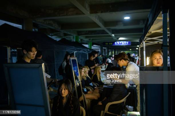 In a photo taken on October 11 performers prepare backstage at the 'Kpop World Festival' in Changwon At the grandly titled and governmentfunded...