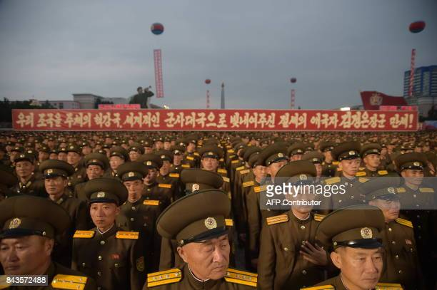 TOPSHOT In a photo taken on September 6 Korean People's Army soldiers attend a mass celebration in Pyongyang for scientists involved in carrying out...
