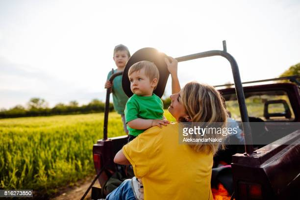 In a pick-up truck at family farm