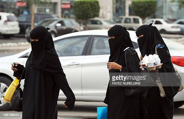 In a picture taken November 19 Saudi women walk with their shopping bags and drinks outside the Olaya mall in Riyadh Women in Saudi Arabia who are...