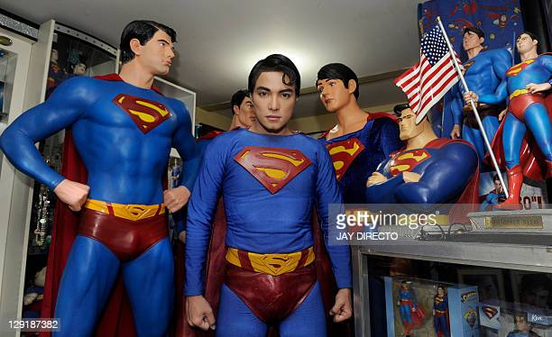 In a picture taken October 13 2011 Filipino fashion designer Herbert Chavez stands dressed like comic book hero Superman among his huge collection of...