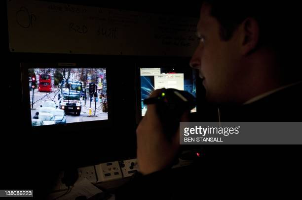 In a picture taken on January 20 2012 a police officer operates an Automatic number plate recognition system equipt police van during traffic checks...