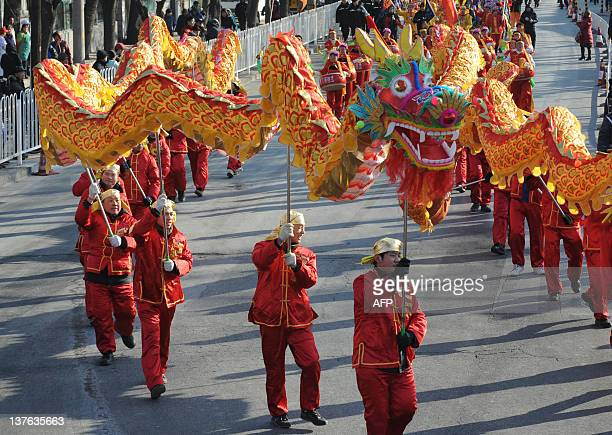 In a picture taken on January 23 Chinese performers entertain visitors on the first day of the Lunar New Year in Beijing China's nearly 135 billion...