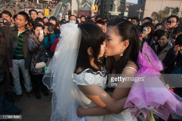 In a picture taken on March 8 2011 a gay couple kiss during their ceremonial 'wedding' as they try to raise awareness of the issue of homosexual...