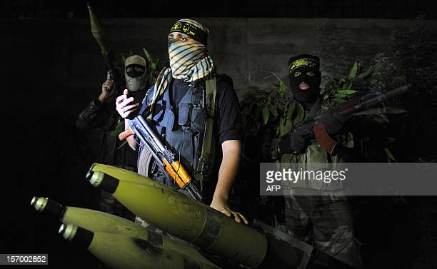 In a picture taken on November 25 Palestinian militants from the armed wing of the Islamic Jihad organization display rockets at an undisclosed...