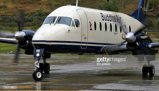 In a picture taken on October 10 2010 a Buddha Air Beechcraft 1900D aircraft taxis on the tarmac after landing at the international airport in Paro...