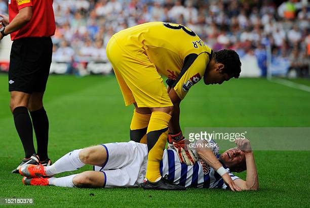 In a picture taken on September 15 2012 Queens Park Rangers' English striker Andy Johnson lies injured during their English Premier League football...