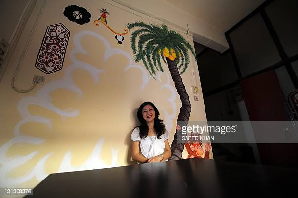 In a picture taken on September 29 Malaysian businesswoman Lok Ann sits in the coffee room of her family's 70 years old hotel in down town Kuala...