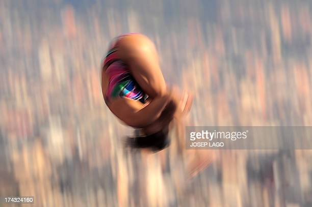 In a picture taken with a slow shutter speed Japan's Mai Nakagawa competes in the women's 10metre platform preliminary diving event in the FINA World...