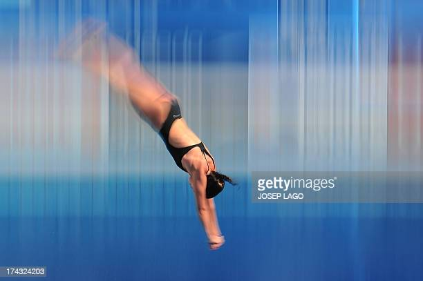 In a picture taken with a slow shutter speed Romania's Mara Elena Aiacoboae competes in the women's 10metre platform preliminary diving event in the...