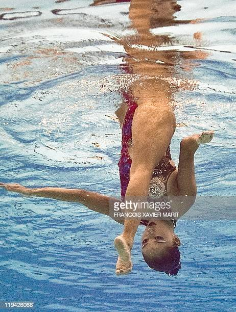 In a picture taken with an underwater camera Japan's Yumi Adachi competes in the final of the solo free synchronised swimming competition in the FINA...