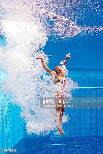 In a picture taken with an underwater camera Ukraine's Anna Pysmenska swims to the surface after a dive in the women's 3metre springboard preliminary...