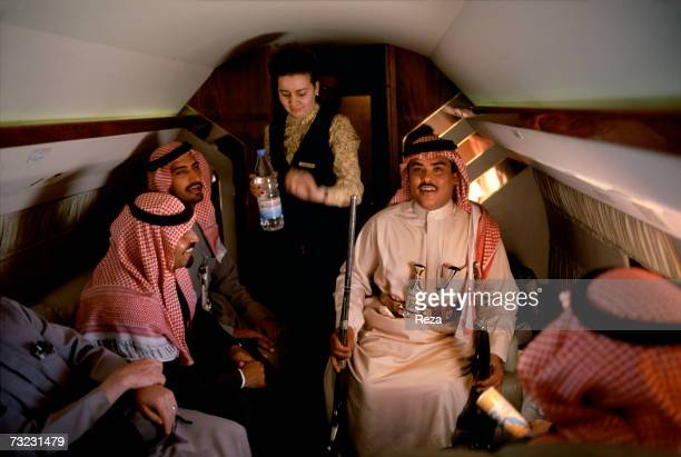 In a plane flown by Prince Sultan bin Salman bin Abdulaziz Al Saud his royal court and bodyguards admire the weapons offered to their prince by a...