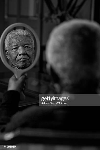 In a previously unreleased portrait Nelson Mandela is pictured in September 2011 at his home in Qunu Eastern Cape as part of photographer and...