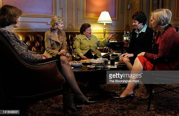 In a private Senator's Only room in the Capitol Senator Barbara Mikulski center is surrounded by her fellow women Senators Senators Lisa Murkowski...