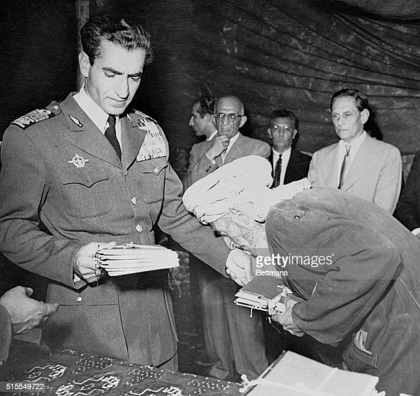 In a program designed to pull the rug from under Communist agitators the Shah of Iran is breaking up vast tracts of land and distributing parcels to...
