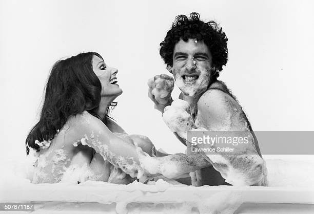 In a promotional portrait for their film 'Move' American actors Paula Prentiss and Elliott Gould clown about in a bubble bath Los Angeles California...