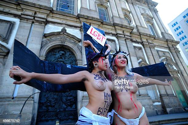 In a protest against homophobia two scantily clad activists kissed in front of the Candelaria church in a mock crucifixion in downtown Rio on...