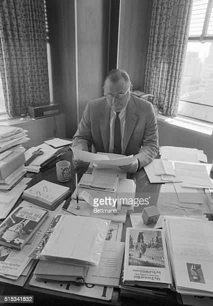 In a proud moment at his Fifth Avenue office Baseball Commissioner Bowie Kuhn reads the list of the ballplayers named to the 1969 AllStar team...