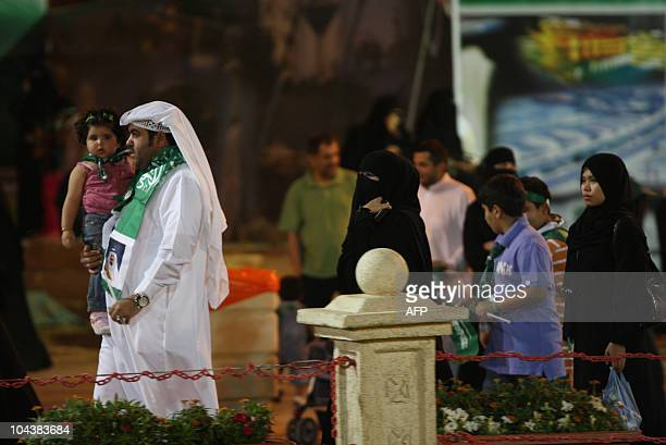 In a rare burst of patriotic gusto Saudis celebrate their national day on September 23 2010 in the capital Riyadh testing hardline clerics who object...