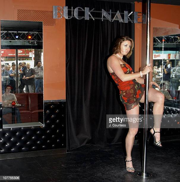 In a recreated scene from SCI Fi Channel miniseries 5ive Days To Midnight Emily Ann Turner dances onstage at the Buck Naked Strip Club as onlookers...