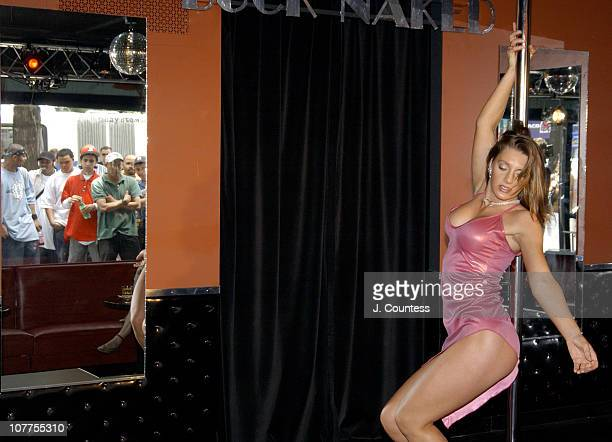 In a recreated scene from SCI Fi Channel miniseries 5ive Days To Midnight Julie Caron dances onstage at the Buck Naked Strip Club