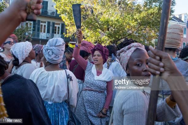 In a recreation of the 1811 German Coast slave rebellion reenactors march through the French Quarter on November 9 2019 in New Orleans Louisiana Part...