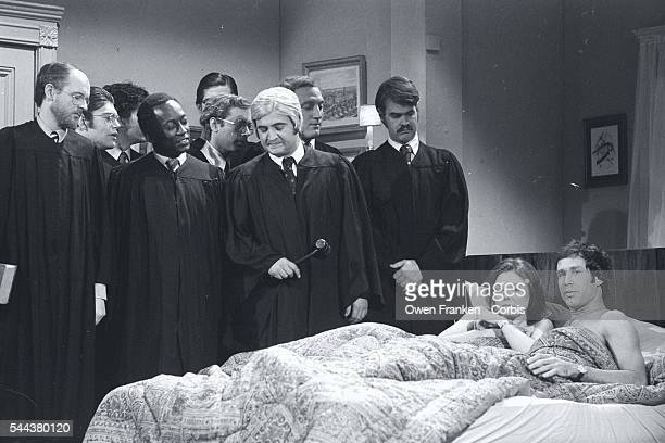 In a Saturday Night Live skit, Chevy Chase and Jane Curtin play a couple monitored in bed by the Supreme Court. The skit aired after the court upheld...