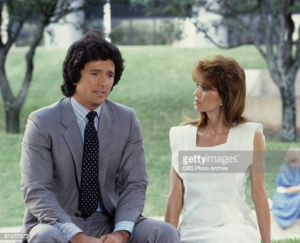 In a scene from the American television series 'Dallas' American actors Patrick Duffy and Victoria Principal sit outside together and talk in an...